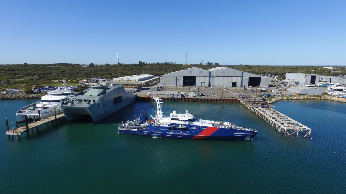 Austal Australia's shipyard in Henderson, WA with one 70m Large Crew Transfer Vessel, one 72m High Speed Support Vessel and one 58m Cape Class Patrol Boat alongside