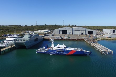 Austal Australia's shipyard in Henderson, WA with a 70m Large Crew Transfer Vessel, a 72m High Speed Support Vessel, and a Cape Class Patrol Boat alongside